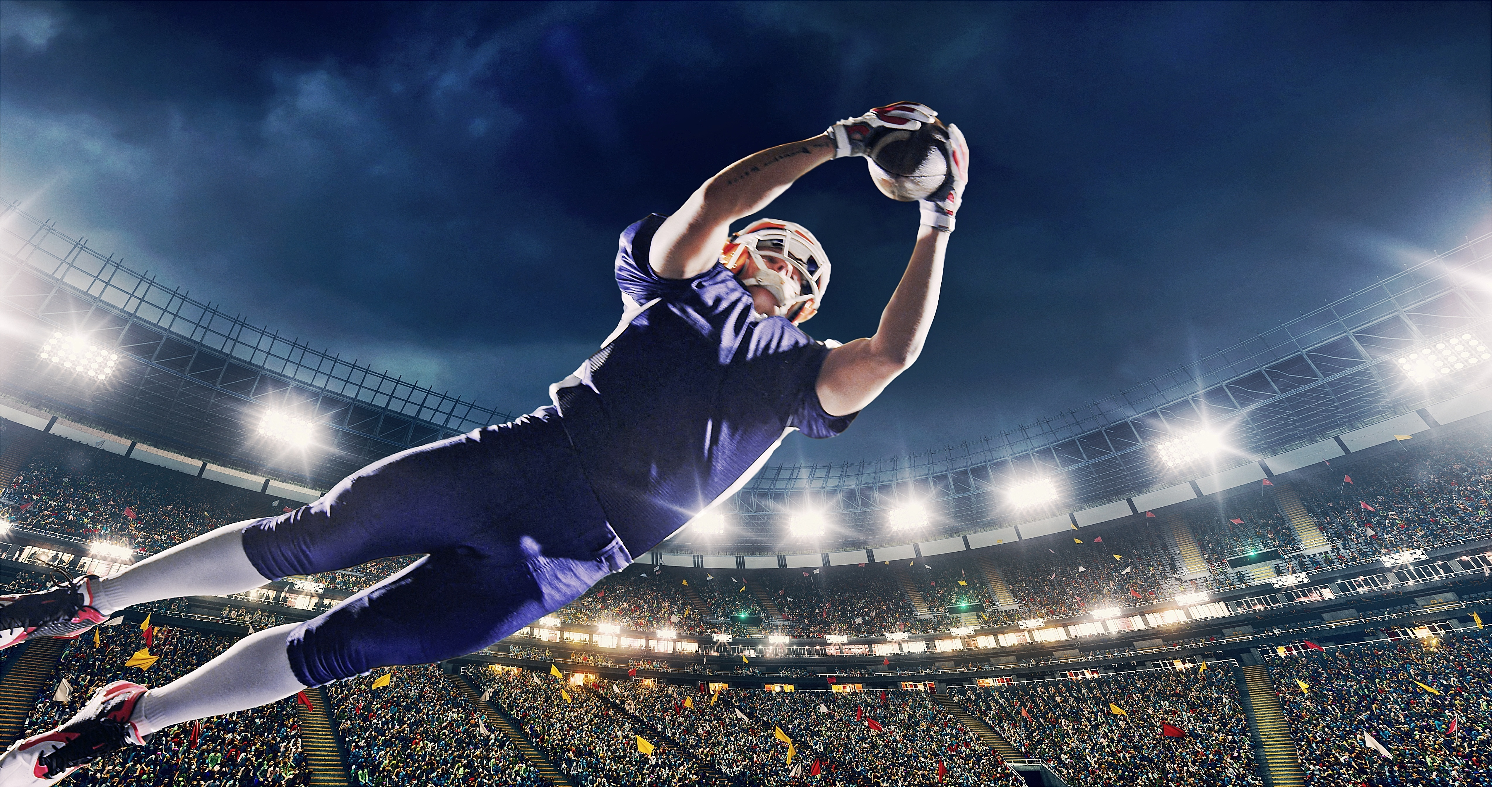 Player catching football in air