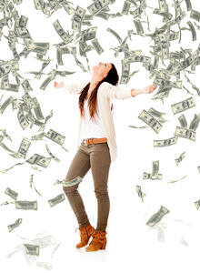Excited woman under a money rain - isolated over a white background