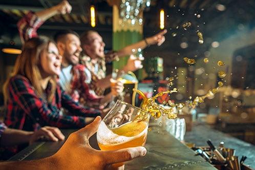 fans-at-bar-cheering